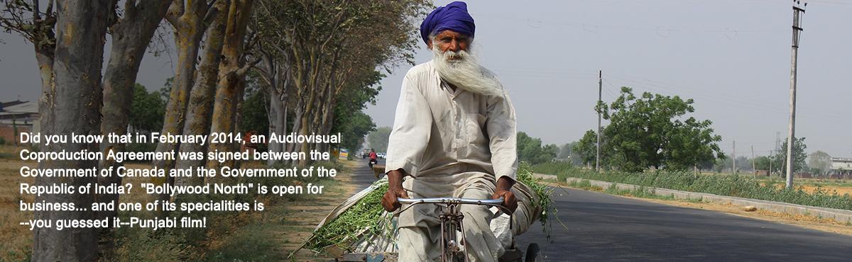 ASIA 365 Punjab Cinema. Man in Punjab riding bicycle
